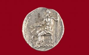 Asclepios seated on a silver Drachma of Epidaurus 270 BC